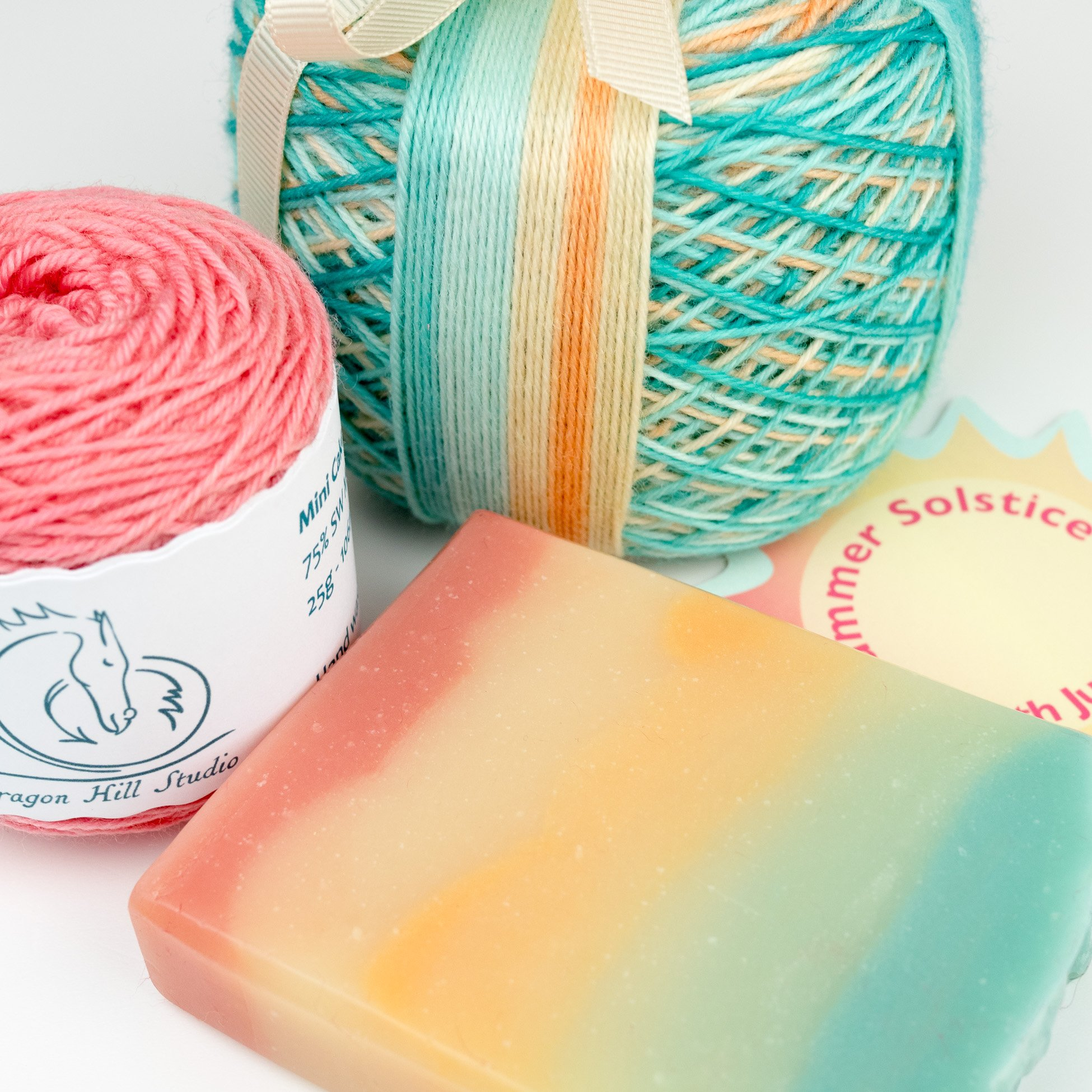 Self striping sock yarn in shades of pale aqua, orange and pink